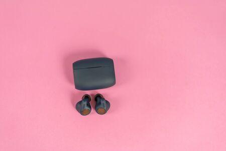 Wireless headphones on pink