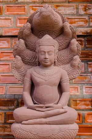 effigy: craftsmanship Buddha carved from sandstone Stock Photo