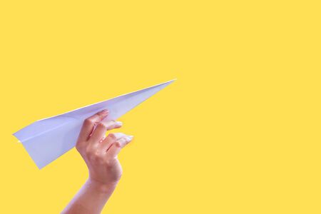 yellow paper: Hand aircraft paper fold to success for design rocket paper.