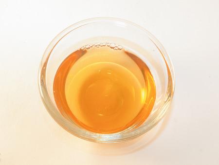 hint: Orange apple vinegar, whit a hint of honey. Isolated on white background