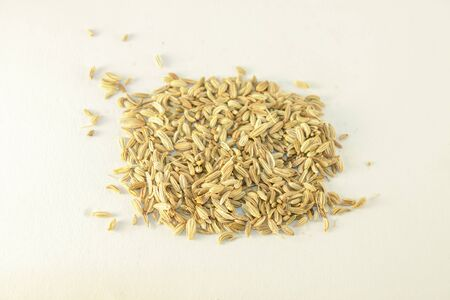 fennel seeds: A lot of fennel seeds, isolated on white background Stock Photo