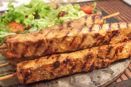 sallad: A lot of brown meat stick and sallad