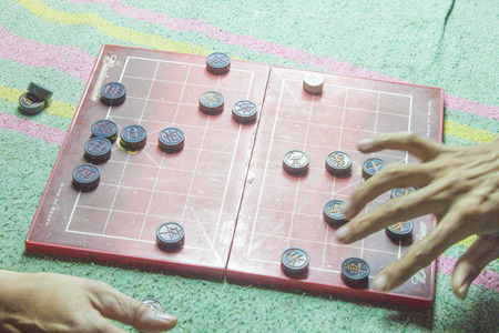 Two men playing, vietnamese chess board game, XiangQi photo