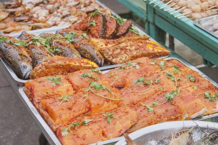loto: A loto of marinated fish, at a market