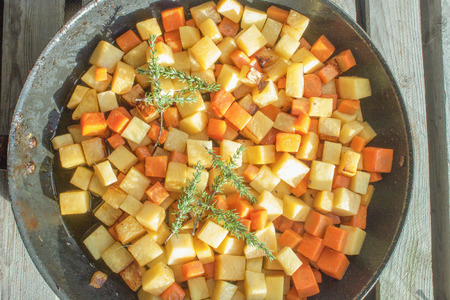 swede: Fried dices of carrot and swede, in a pan + thyme
