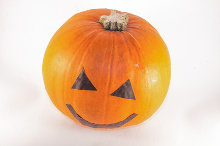 smilling: Orange halloween pumpkin, isolated on white background