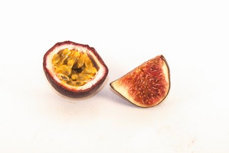 purple fig: A colorful passion fruit and purple fig, on white background