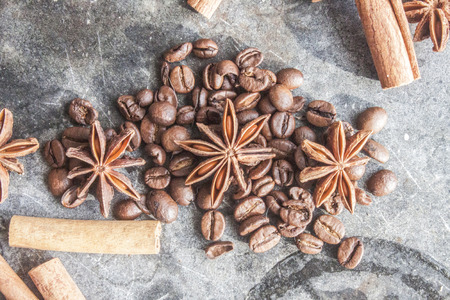 anis: Star anis, coffe beans and cinnamon sticks, on a stone plate Stock Photo