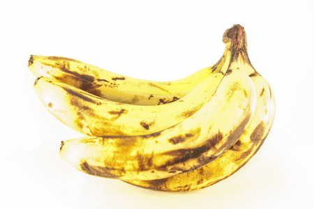 bad banana: A pile of old bananas, isolated on white background