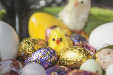 animal figurines: Eastern chicken, between eastern eggs, in a basket