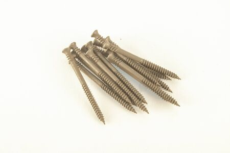 drywall: Black drywall screws, isolated on white background Stock Photo
