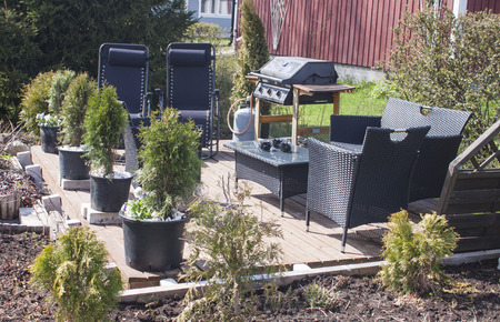 shiny day: Deck furniture on terrace, on a shiny day