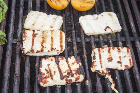 haloumi: A lot of grilled halloumi, on a barbeque