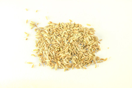 saunf: A lot of fennel seeds, isolated on white background Stock Photo