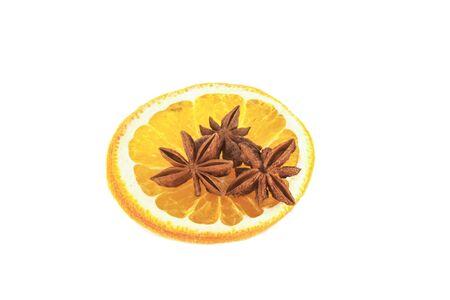 anis: Star anis on a yelloy orange, on isolated white background Stock Photo