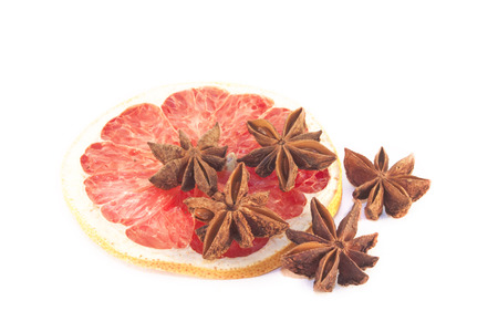 anis: Brown star anis on a blood, red grape fuit slice