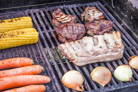 cutlass: Grilling meat and vegetables, including sweetcorn, carrots, onions, pork cutlass, veal steak and pork ribs