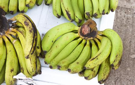 musa: A lot of fresh, green bananas, Musa acuminata,  at a market in Phu quoc, Vietnam Stock Photo