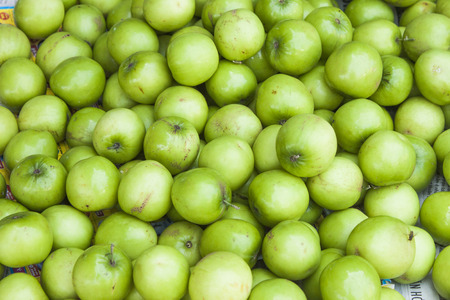 green apples: A lot of green star apples, chrysophyllum cainito at a market in Phu Quoc, Vietnam