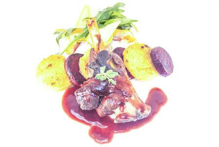 shank: A portion of lamb shank, polenta, beetroot an salad Stock Photo