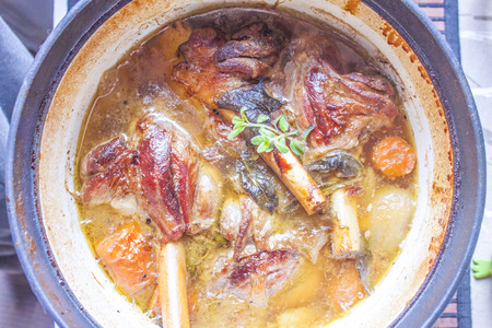 lamb shank: A stew full of tasty lamb shank, herbs and carrots