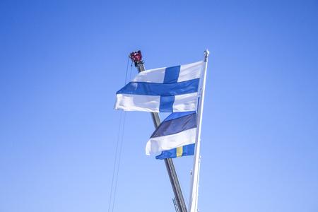 estonian: Finnish flag, in front of estonian and swedish flag