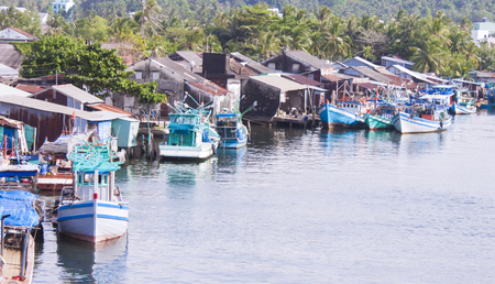 dong: Blue fishing boats, at a fisher village, at Phu quoc, in duong dong, Vietnam Editorial