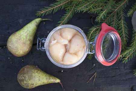 conserved: Pickled, conserved and prepared pears, inside a glass can