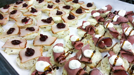 peppermint cream: Ham and turkey cocktail breads, with cranberry marmelade, peppermint cream and balsamico sauce