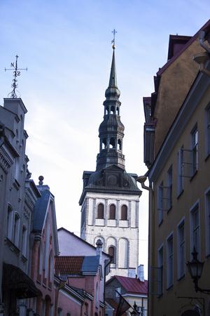 kirk: View of oleviste kirk church, above colorful houses, in tallinn, estonia