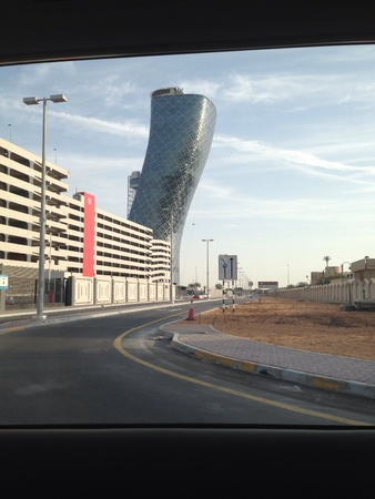 Capital Gate in Abu Dhabi UAE which has gotten an entry into Guinness book of world records because of its curvature and leaning angle. Its a sight to see in real specially with straight buildings all around it Stok Fotoğraf