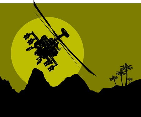 helicopters: silhouette of a military helicopter in the night sky over the desert