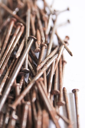 Several nails rust on a white background. Stock Photo - 7515034