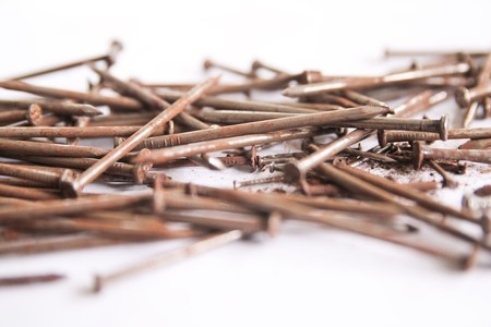 Several nails rust on a white background. Stock Photo - 7515035