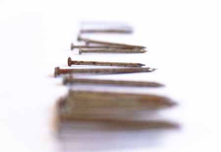 Several nails rust on a white background. Stock Photo - 7637555