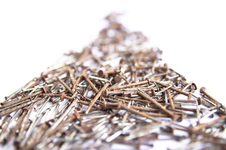 Several nails rust on a white background. Stock Photo - 7637596