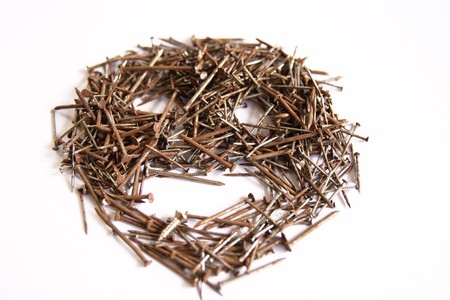 Stack of  nails. Several nails rust on a white background. photo