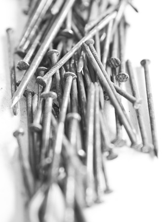 Several nails rust on a white background. photo