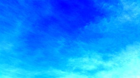 Deep blue sky images shot with blending clouds. Clean blue area with just a smoot cloud to use as a backdrop in your work space. Royalty free stock photograph.
