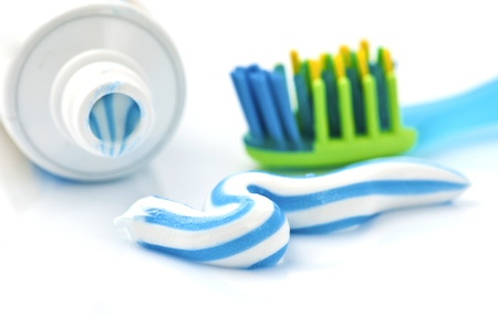 squeezing: toothpaste with tube and toothbrush