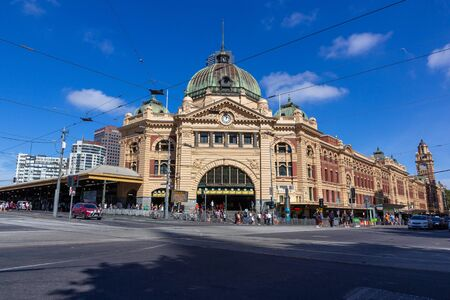 Melbourne city historic building-Flinders street station built of yellow sandstone in colonial victorian style.The station is the major interchange for suburban trains in Melbourne:09042018