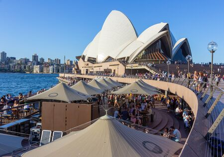 Tourists at waterfront Sydney Opera Bar in  sunny day with beautiful blue sky and harbour bridge in Sydney, Australia 07/04/2018 스톡 콘텐츠 - 136765204