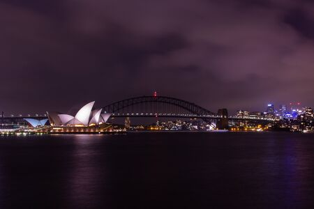 opera house and harbour bridge in Sydney at night, It is illuminated by golden lights .Australia : 04/02/18 스톡 콘텐츠 - 136765290