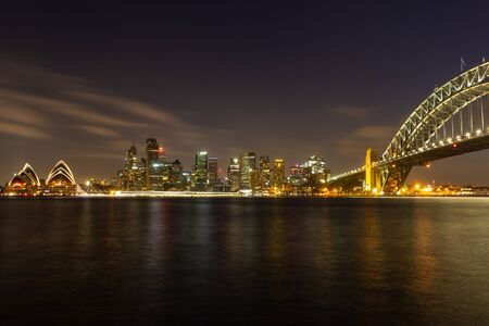 opera house and harbour bridge in Sydney at night, It is illuminated by golden lights. Australia : 31/03/18 스톡 콘텐츠 - 136765298