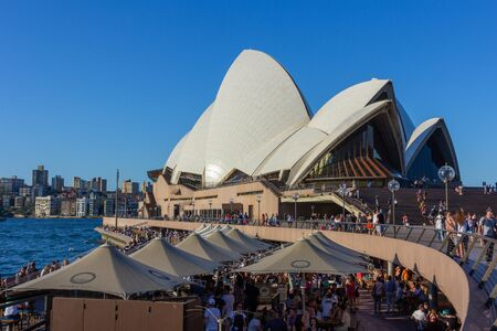 Tourists at waterfront Sydney Opera Bar in  sunny day with beautiful blue sky and harbour bridge in Sydney Australia 07/04/2018 스톡 콘텐츠 - 136769841