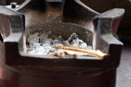 old asian stove with burn charcoal