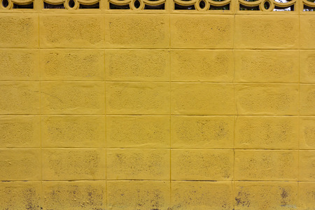 Old yellow concrete block wall ,use for background 스톡 콘텐츠