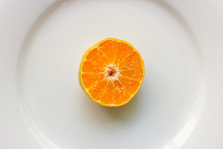 Top view of fresh sliced  oranges on the plate