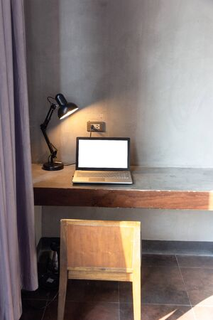 laptop with blank white screen for mock up template background on Table