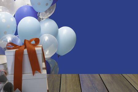 New Year or Valentine day with gift box and colorful ballon on blue background.  스톡 콘텐츠